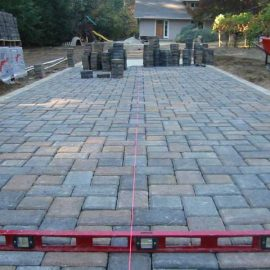middle stages of a paver driveway